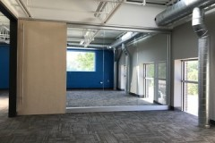Glass-wall-office-partition-with-sliding-wood-door-Tiffany-Springs-Kansas-City-MO-1