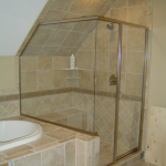 A corner shower with custom glass from Santa Fe Glass in Independence, MO