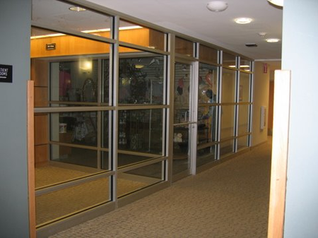 An office hallway with glass windows installed by Santa Fe Glass in Independence, MO