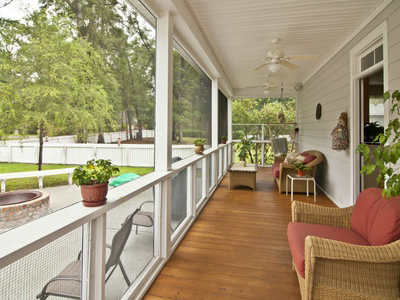 A screened-in porch with screens purchased from Santa Fe Glass in Independence, MO